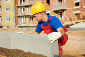 Builder installing road concrete kerb — Stock Photo