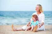 Woman and child at sea beach — Stock Photo