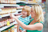 Woman and boy making shopping — Stock Photo