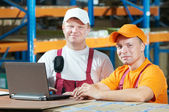 Manual workers in warehouse — Stock Photo