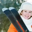 Royalty-Free Stock Photo: Girl at winter clothing with skis