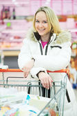 Woman making dairy shopping — Stok fotoğraf