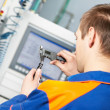 Worker measuring detail tool — Stock Photo