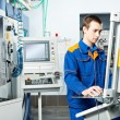 Stock Photo: Worker at machine tool in workshop