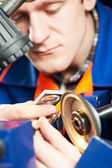 Worker measuring detail — Stock Photo