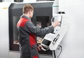 Laborer working with machine tool — Stock Photo