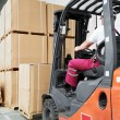 Worker driver at warehouse forklift loader works — Stock Photo #9168117