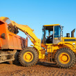 Stock Photo: Wheel loader excavator and tipper dumper