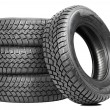 Stack of four car wheel winter tires isolated - Stock Photo