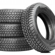 Stock Photo: Stack of four car wheel winter tires isolated