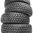 Stack of four car wheel winter tires isolated — Stock Photo
