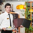 Waiter in uniform at restaurant — Stock Photo