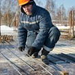 Builder works with concrete reinforcement — Stock Photo #9172057