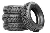 Stack of four car wheel winter tires isolated — 图库照片