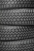 Background of four car wheel winter tires — Stock Photo