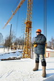 Worker with tower crane remote control equipment — Foto Stock