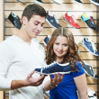 Man and assistant at shoe shopping - Stock Photo