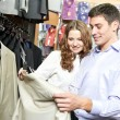 Young peoples shopping at clothes store - Stok fotoğraf