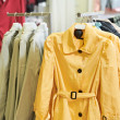 Clothes on hanger in shop - Stockfoto