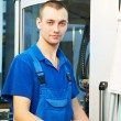 Worker at machine tool in workshop — Stock Photo