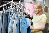 Woman at jeans pants shopping store — Stock Photo