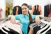 Woman seller consultant in clothes shopping store — Zdjęcie stockowe