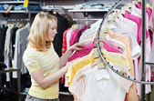Young adult woman at clothes shopping — Stock Photo