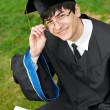 Happy graduate student in gown — Stock Photo