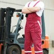 Warehouse worker in front of forklift — Stock Photo #9371915