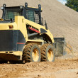 Skid steer loader at earth moving works — Stock Photo #9372059