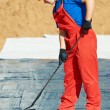 Builder worker at roof insulation work — Stock Photo #9372282