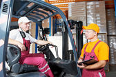 Warehouse workers in storehouse — Stock Photo