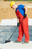 Builder worker at roof insulation work — Stock Photo