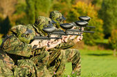 Paintball players team aiming markers — Stock Photo