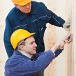 Electricians at cable wiring work — Stock Photo #9402690