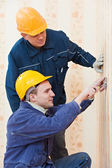 Electricians at cable wiring work — Stock Photo