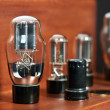Electronic amplifier with bulb lamp close-up — Stock Photo #9429654