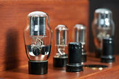 Electronic amplifier with bulb lamp close-up — Stock Photo
