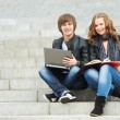 Two smiling young students outdoors — Stock Photo #9451501