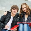 Two smiling young students studying outdoors — Stock Photo #9451525