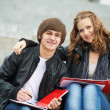Two smiling young students studying outdoors — Stock Photo