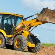 Excavator Loader with backhoe works — Stock Photo #9452015