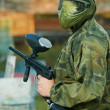 Shooted paintball player — Stock Photo