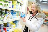 Woman making dairy shopping — Stock Photo
