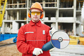 Builder worker at construction site — Stockfoto