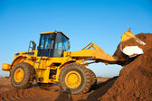 Wheel loader excavator at work — Stock Photo