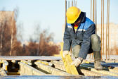 Construction worker preparing formwork — Stock Photo
