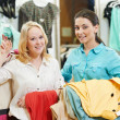 Royalty-Free Stock Photo: Two Young women at apparel clothes shopping