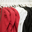 Clothes on hanger in shop — Stock Photo #9539545