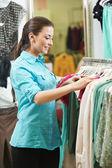 Young woman at shirts clothes shopping — Stock Photo